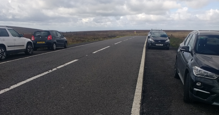 Cars parked on the Snake Pass.