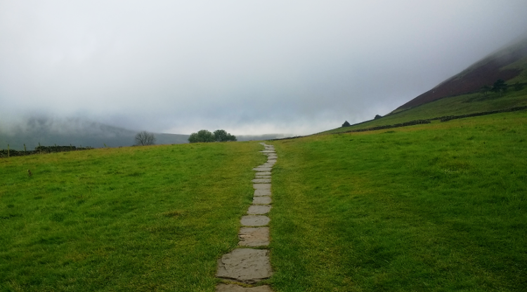 Flagstones lead through dense mist on the Pennine Way
