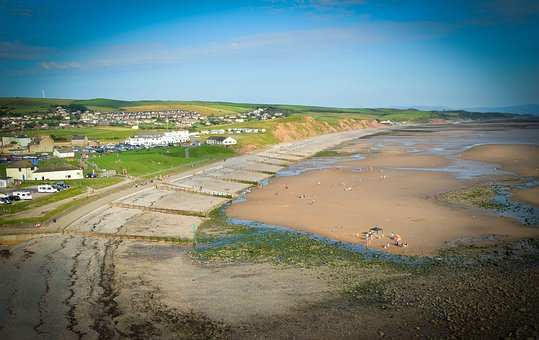 Walking holidays through St Bees include this Cumbrian beach, with sand and cafes in view