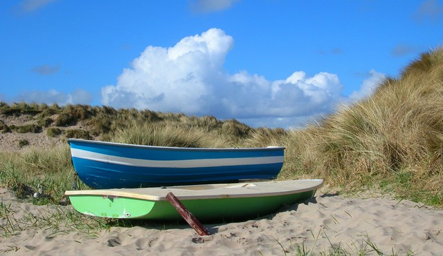 Boats at Beadnell Bay on Northumberland Coast Path - walker interview