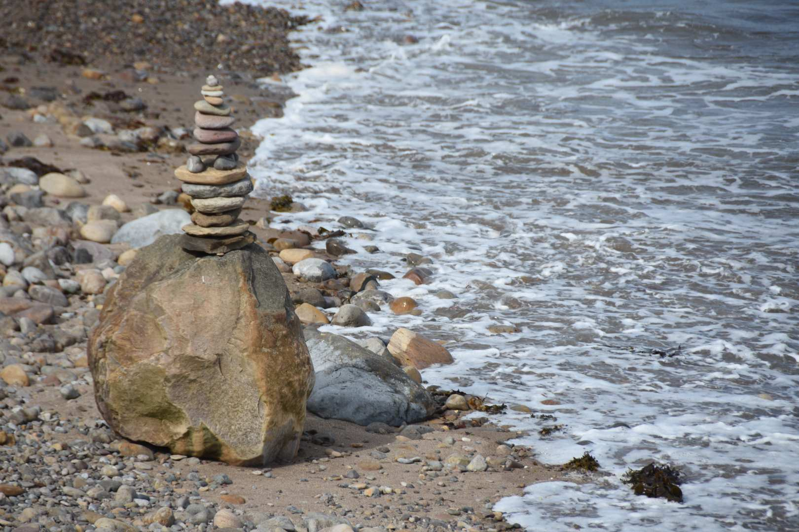 """Stone Sculpture on the Beach at Holy Island"" by Elizabeth Hurrell (2020)"